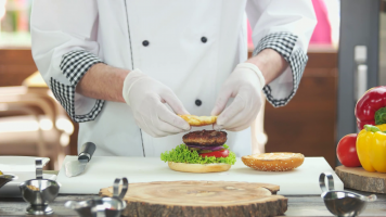 videoblocks-chef-making-a-tasty-burger-meat-egg-and-cheese_radxqpsfsf_thumbnail-full01